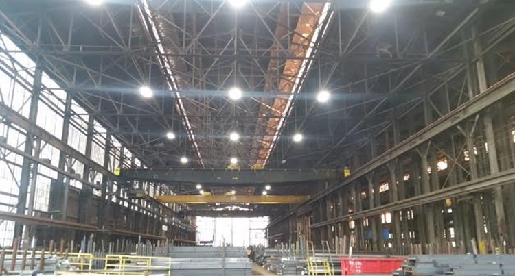 picture of a steel warehouse with a lighting retrofit job, picture of a steel warehouse with high bay led lighting
